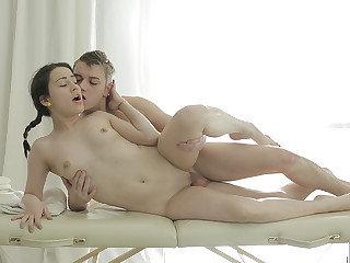 Teeny fucked on massage table
